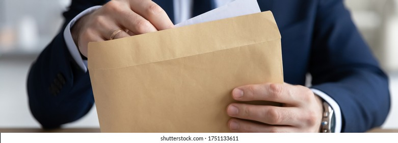 Horizontal panoramic view of businessman open envelope with postal paper letter in office, male employer or boss in formal suit get post paperwork document or correspondence at workplace