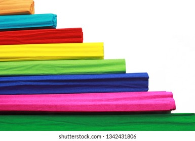 horizontal pattern with colorful crepe paper rolls in front of a white background