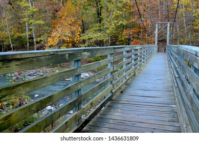 Horizontal perspective shot of suspension walking bridge over stream at Devil's Den State Park in Arkansas.