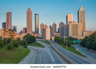 Horizontal photo of the Atlanta skyline as seen in the early morning from the Jackson Street Bridge (all business names on buildings have been edited out of the photo)