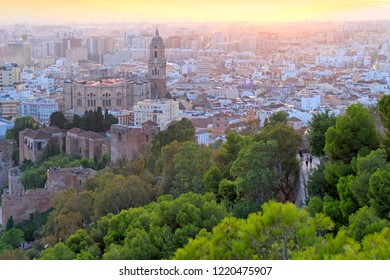 Horizontal photo of beautiful sunset of Malaga city, Spain. There are a palatial fortification - the Alcazaba and Cathedral of Malaga