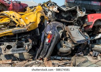 Horizontal photo of a car scrap yard