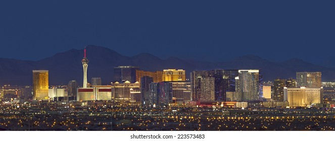 Horizontal photo of Las Vegas with mountain backdrop at night. - Shutterstock ID 223573483