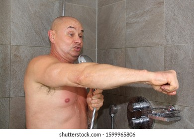 horizontal photo of a man who washes in the shower under the stream of water and sings