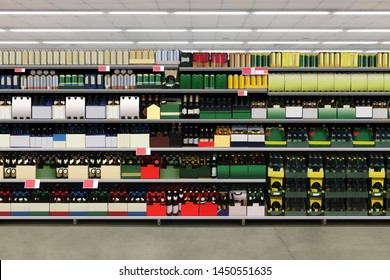 Horizontal photo mockup of Beer bottles and cans on shelves in supermarket brandles and suitable for presenting new beer bottles and packaging or label designs among many others.