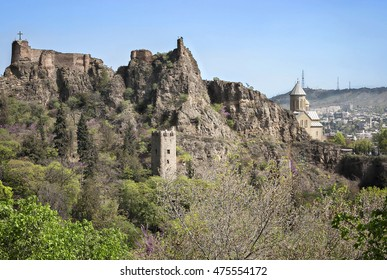Horizontal photo of the Narikala Fortress with the St Nikolas church and the architecture in the surrounding Old Town of Tbilisi, Republic of Georgia