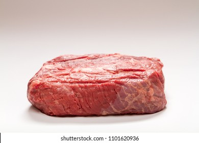 Horizontal Photo of Raw Beef Roast On White Background Medium Wide Shot with Copy Space