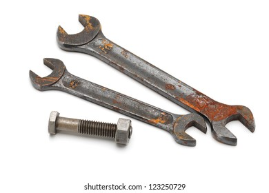 horizontal photo rusty and old wrench, close up on white background