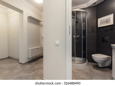 Horizontal photo small grey bathroom placed in the hall