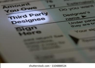 Horizontal Photo with Third Party Designee Spotlit on Document