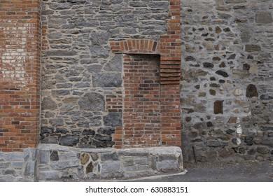 Horizontal photo of trace of door walled off in brick