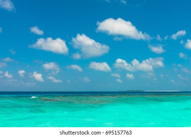 Horizontal picture from the boat of turquoise water at Maafushi during a sunny day with blue sky, Maldives.