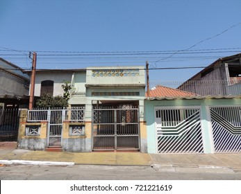 An horizontal picture of a facade of a typical suburban house in São Paulo / Brazil on a sunny day,