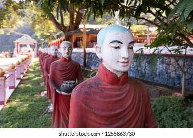 Horizontal picture of many aligned monks statues at Kaw Ka Thaung Cave, located close to Hpa-An, Myanmar