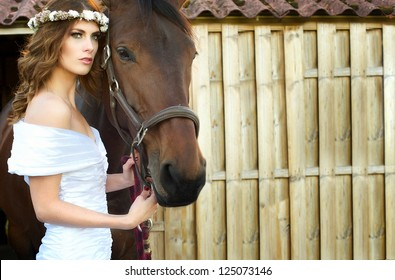 Horizontal portrait of a beautiful bride and horse