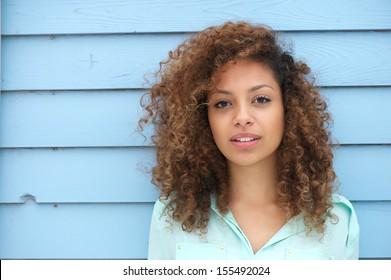 Horizontal portrait of a beautiful young african woman looking at camera