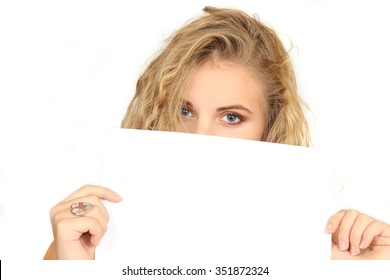 horizontal portrait of the girl on a white background. holds a clean sheet in hand.