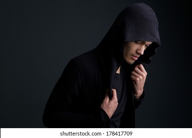 Horizontal portrait of a male fashion model posing on gray background