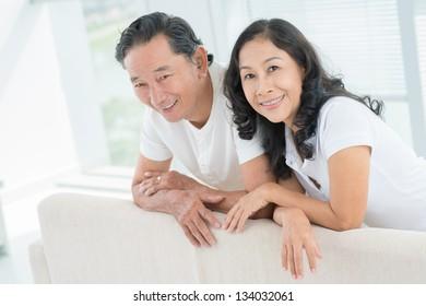 Horizontal portrait of seniors smiling and looking at camera