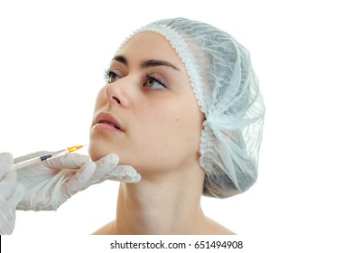 horizontal portrait serious young girl without makeup in the medical doctor at Hat