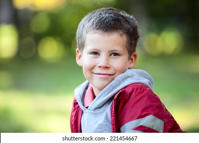 Horizontal portrait of a six year old Caucasian boy in a red jacket