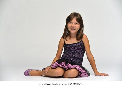 Horizontal portrait of a young girl sitting on the floor