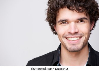 Horizontal portrait of a young handsome caucasian man smiling. Male model looking at camera. Copy space friendly face