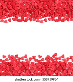 Horizontal seamless background, red hearts candy sprinkles over