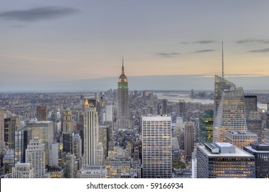 A horizontal shot of the awe inspiring skyline of midtown Manhattan just after sunset. Note the cool, silvery tones of the city
