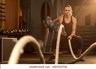 Horizontal shot of a beautiful athletic woman working out with ropes at crossfit box gym copyspace confidence motivation sports lifestyle activity hobby healthy powerful femininity training