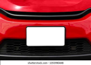 Horizontal shot of a blank white front license plate on a red car with copy space.