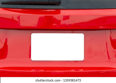 Horizontal shot of a blank white license plate on a red car with copy space.
