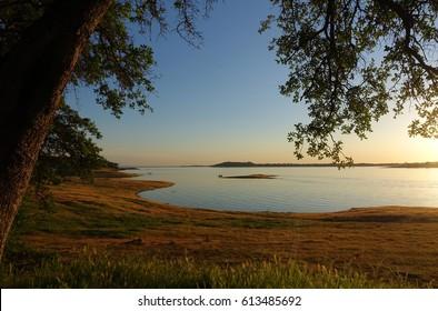 Horizontal shot of a calm lake before sunset.