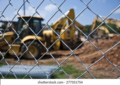 Horizontal Shot of Construction Site With Chain Link Fence
