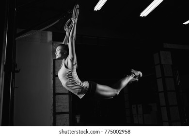 Horizontal shot a crossfit and fitness female athlete working out on gymnastic rings grip arms body healthy confident determined motivation improvement fitness athlete women beauty concept, crossfit