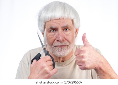 Horizontal shot of a gray haired man who's been in quarantine too long finally approves the haircut he gave himself with a thumbs up.