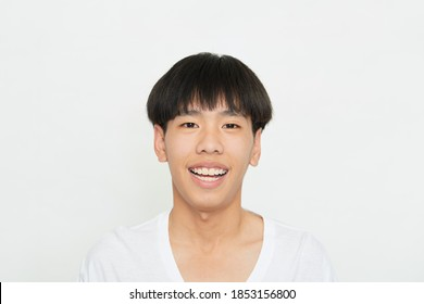 Horizontal shot of a handsome young guy with Brown eyes positive expression, being praised by someone, dressed casually, isolated white studio background