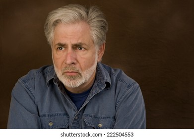 Horizontal Shot Of Man Looking Worried With Copy Space/ Worried Sad Man