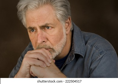 Horizontal Shot Of Man Showing Concern Or In Deep Thought/ Deep Thoughts