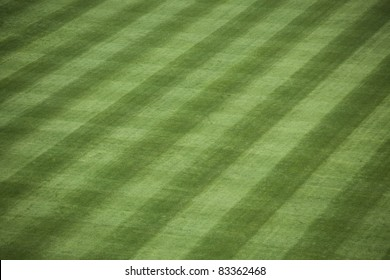 Horizontal shot of manicured outfield grass at a baseball stadium.