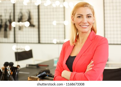 Horizontal shot of a mature businesswoman beauty salon owner smiling to the camera posing proudly at her studio copy space. Entrepreneurship, profession, job, career concept