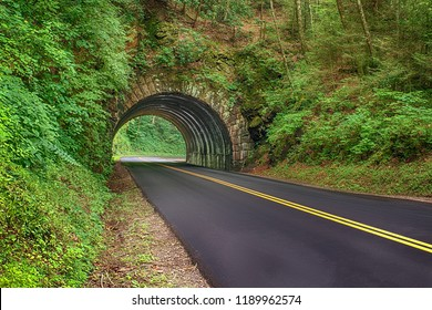 Horizontal shot of a new blacktop road going through a tunnel in the Smoky Mountains National Park in Tennessee.