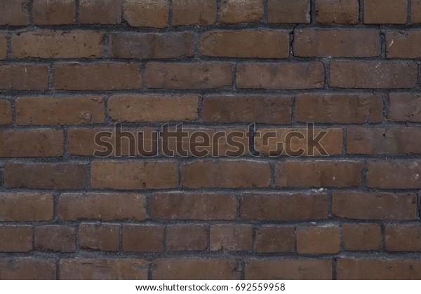 Horizontal shot of an old, worn brick wall