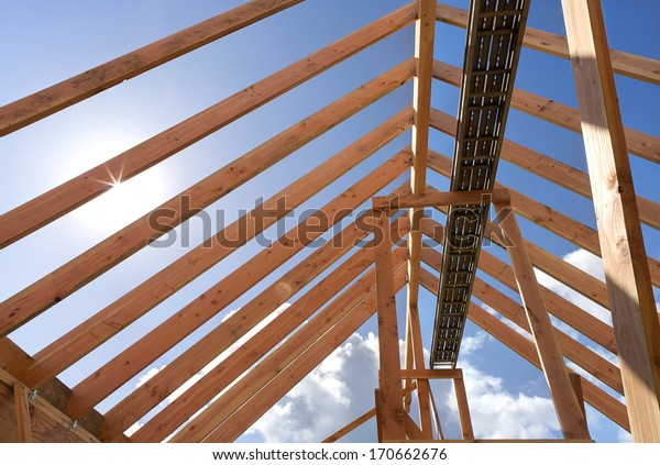 Horizontal Shot Post Beam Roof Construction Stock Photo