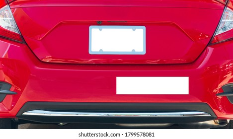Horizontal shot of the rear of a red car with a blank white license plate and bumper sticker.  Good copy space.