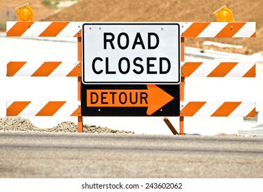 Horizontal Shot Of 'Road Closed' Barrier With Detour Sign