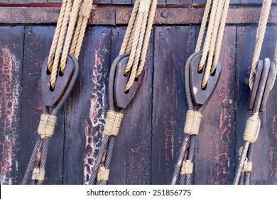 Horizontal shot of tackled rope at a sailing boat