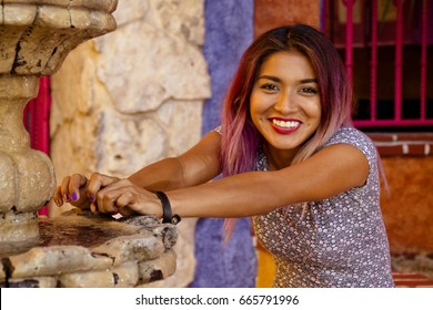 Horizontal shot of young mexican girl with a positive expression , looking at the camera and smiling