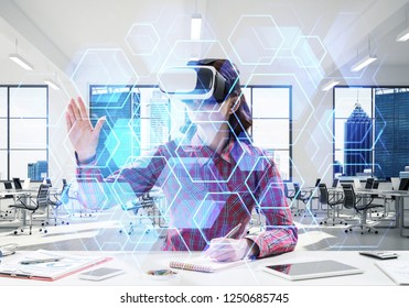 Horizontal shot of young woman in checkered shirt using virtual reality headset with media interface while sitting inside bright building. VR technologies for educational process