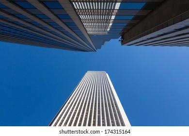Horizontal skyscraper reflection over Chicago blue sky